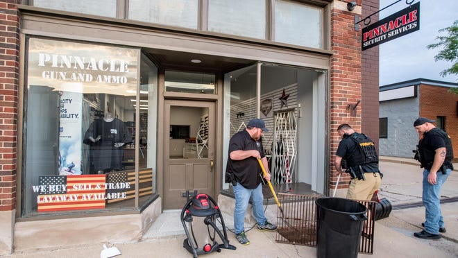 Pinnacle Security Services owner Scott Helms, left, and two of his employees help clean up glass from a broken front window Monday, June 1, 2020 after alleged burglars broke in to the Downtown Peoria store overnight.
