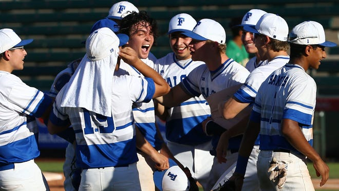 Tucson Catalina Foothills celebrates their 2-1 win over Phoenix St. Mary's during the 4A high school state tournament on May 9, 2018 at Tempe Diablo Stadium in Tempe, Ariz.