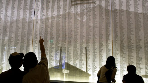 Visitors search for their names and those of their