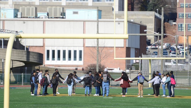 Hackensack High School students gathered at the 50-yard line of the football field and held hands in silence on Wednesday morning March 14, 2018. Approximately 30 students participated in the event. Police and school officials watched from the sidelines.