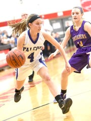 Falcon Gracen Donmoyer pushes past Lancaster Catholic's Lillian Fritz at Warwick High School, Wednesday, Feb. 10.