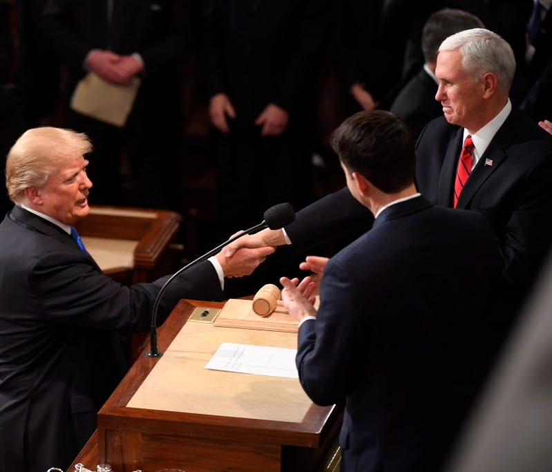 President Trump greets Vice President Pence before delivering the State of the Union Address on Jan. 30, 2018.