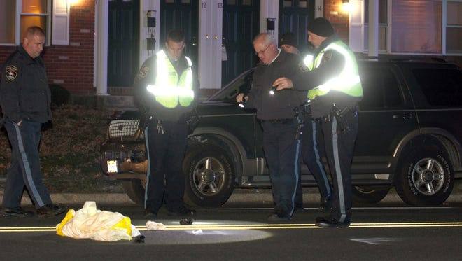 Brick Township Police investigate the scene along Old Hooper Avenue in front of the Brick Gardens Apartment where a woman was struck by a vehicle Monday evening, November 23, 2015.