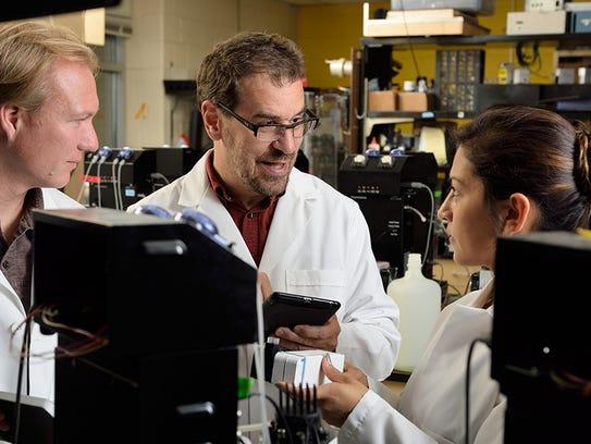 David Kramer, center, is the Hannah Distinguished Professor