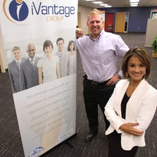 Information technology staffing and recruiting firm iVantage Group has moved to new offices in Brighton Township. Pictured are Bryan Shrader, vice president of sales and recruiting, and his wife, President and CEO Juliet Shrader. The Shraders live in Brighton.