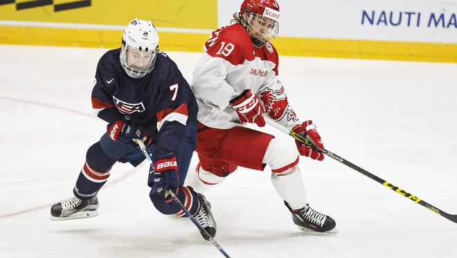 USA's Matthew Tkachuk, left, and Denmark's Nikolaj Krag vie during the World Junior Ice Hockey Championship match between Denmark and the USA in Helsinki, Finland on Friday, Dec. 31.