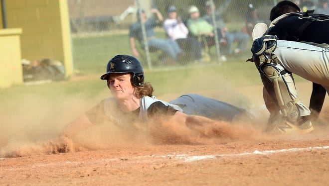Delone Catholic's Ryan Hart reaches for home plate while he slides in for a run, Friday, April 13, 2018. The Biglerville Canners beat the Delone Catholic Squires, 5-4.