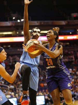 Phoenix Mercury forward Camille Little (20) last the ball in against Atlanta Dream forward Sancho Lyttle (20) during the second quarter at Talking Stick Resort Arena in Phoenix, Ariz. July 12, 2017.