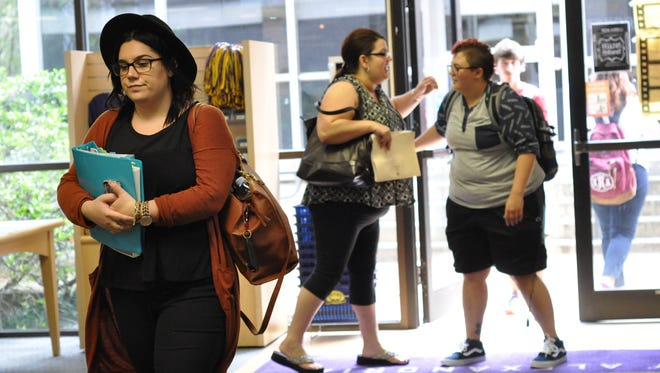 Adrianna Brunson (left) and other students congregate in the bookstore on the campus of Louisiana State University of Alexandria on the first day of school Monday.