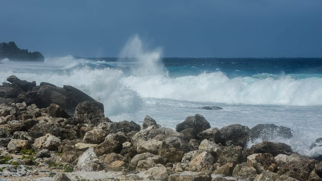 Ocean waves pound on the reef and rocks near the Port Authority of Guam on Thursday, Jan. 19, 2017.