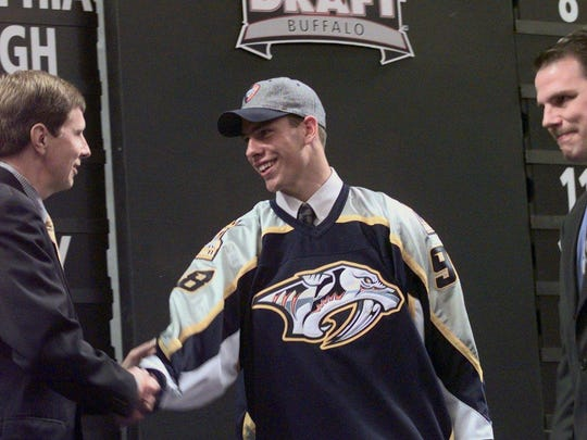 Predators general manager David Poile congratulates first-round pick David Legwand in 1998.