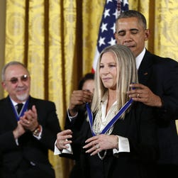 President Obama presents the Presidential Medal of Freedom to Barbra Streisand.
