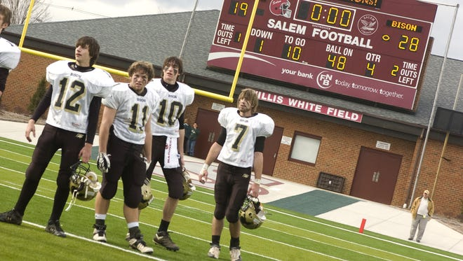Buffalo Gap's Casey Lewis, Alex Brown, Boone Jones and Travis Morris stand to one end of the field on Dec. 8, 2007, in Salem waiting for the team to be awarded the Group A, Division 1 state championship trophy