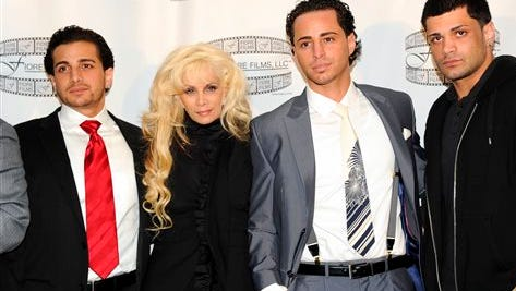"""In this 2011 file photo, Carmine Gotti Agnello, from left, Victoria Gotti, John Gotti Agnello and Frank Gotti Agnello attend a press conference for the film """"Gotti: Three Generations,"""" in New York. Victoria Gotti and her sons starred in the A&E reality series """"Growing Up Gotti,"""" a decade ago. Now the network is reuniting the cast for a one-hour retrospective, """"Growing Up Gotti: 10 Years Later,"""" airing Mondays."""