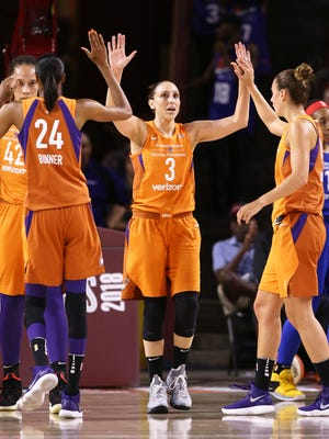 Phoenix Mercury Diana Taurasi high-fives after a basket against the Dallas Wings in the first half during the round one of the WNBA Playoffs on Aug. 21, 2018, at Wells Fargo Arena in Tempe, Ariz.