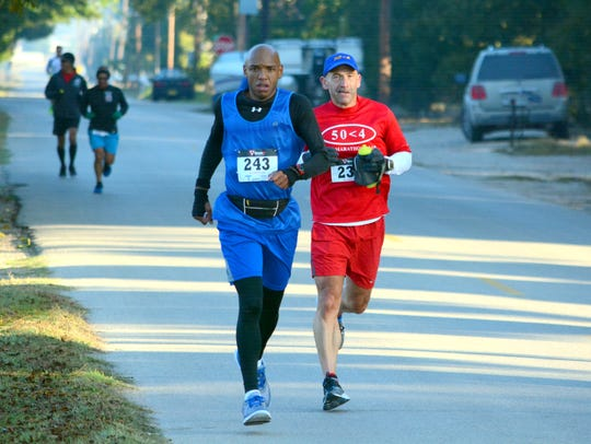 Terrance Orgain (243) and Jim Roche (234) try to run
