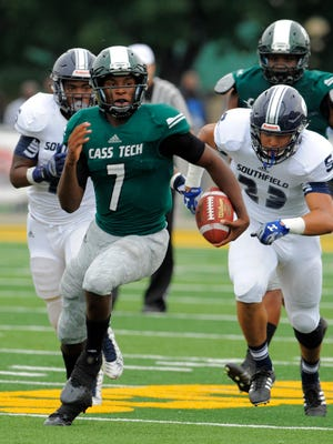 Cass Tech quarterback Rodney Hall breaks away from the Southfield defense on Saturday.