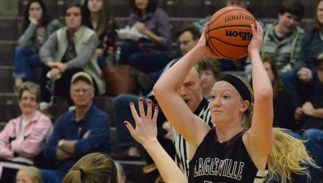 Eagleville's Kristin Barnes looks for a teammate to pass to during Tuesday night's 43-36 loss to Page.