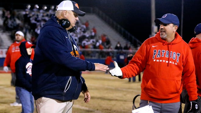 Blackman's David Watson shakes hands with Oakland's Kevin Creasy after the Patriots beat the Blaze during the second round of the Class 6A state playoffs last November. Watson will join the Oakland staff next season.