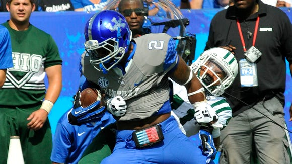 UK's Dorian Baker scores against Ohio's Ian Wells, on an 8-yard pass from Patrick Towles, Saturday, Sept. 06, 2014, at Commonwealth Stadium in Lexington.
