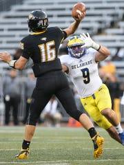 Delaware's Troy Reeder pressures Towson quarterback