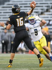 Delaware's Troy Reeder pressures Towson quarterback Ryan Stover in the third quarter of Towson's 18-17 win at Johnny Unitas Stadium in Towson, Md. in Oct. 2017.