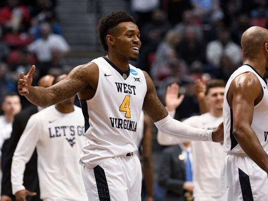 West Virginia guard Daxter Miles Jr. (4) reacts after West Virginia defeated Murray State 85-68 in a first-round NCAA college basketball tournament game Friday, March 16, 2018, in San Diego. (AP Photo/Denis Poroy)