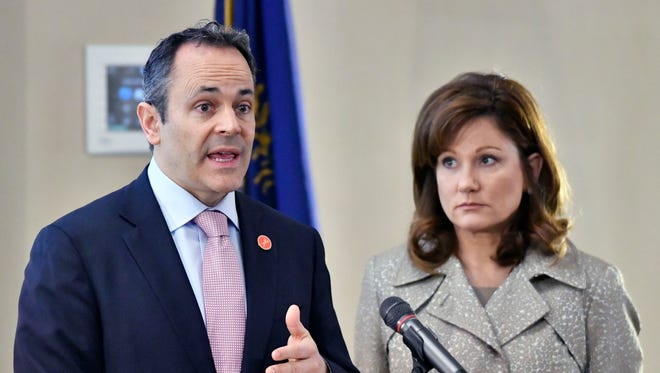Kentucky Governor Matt Bevin, left, and First Lady Glenna Bevin address the opening conference of The Open Hearts/Open Homes Summit to Save Our Children in Frankfort,, Ky.  Friday, Mar. 10, 2017