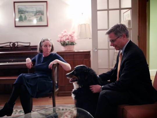 Federal judge Terrence G. Berg and his wife Anita Sevier photographed with family dog, Rusty, at their home on Thursday, Nov. 19, 2015, in Detroit.