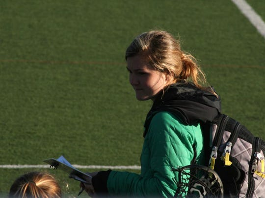 Grace O'Neil looks to the Essex bench during a girls lacrosse game last season. She was named the Hornets' new head coach last week.