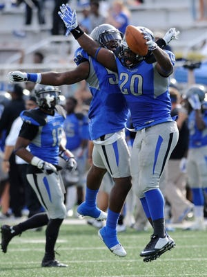 Faulkner's Mitchell Hoskins (20) and Randall Reese (55) celebrate Hoskins' fumble recovery against Lindsey Wilson on Saturday September 26, 2014 at Faulkner University in Montgomery, Ala.