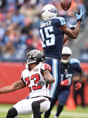 Titans wide receiver Justin Hunter tries to haul in a pass against the Falcons in the first quarter.
