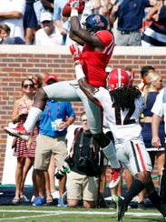 Mississippi wide receiver A.J. Brown (1) catches a
