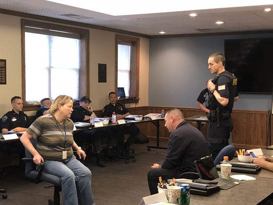 Officers participate in role play during a crisis intervention