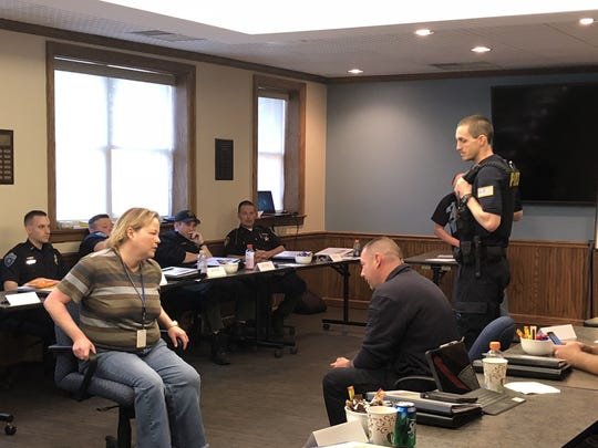 Officers participate in role play during a crisis intervention training at Paint Valley ADAMH.
