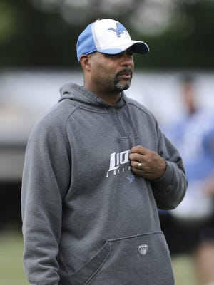 Detroit Lions defensive coordinator Teryl Austin watches during NFL football practice in Allen Park, Mich., Tuesday, June 3, 2014.