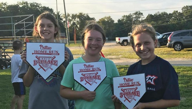 Millville's Kylie Tomlin (left), Emily Praul (center) and Sadie Drozdowski finished first, second and third, respectively, in the Philadelphia Phillies home run derby regional at Millville on Tuesday.
