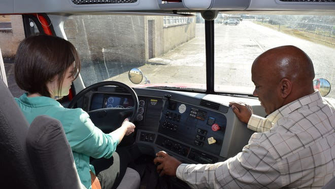 In this file photo, Ramon Milano (right), an instructor for the Commerical Driver's License program at Central Louisiana Technical Community College, shows The Town Talk education reporter Leigh Guidry the controls of a real 18-wheeler. Guidry prepared by driving the new truck driving simulator at CLTCC.