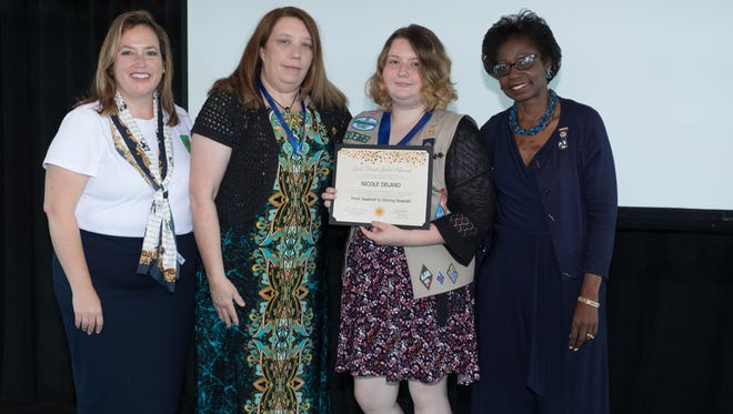 GSSEF CEO Lisa Johnson, Betsy Delano, and GSSEF board chair Lorna Brown Burton proudly give Nicole Delano (middle right) her Gold Award recognition.