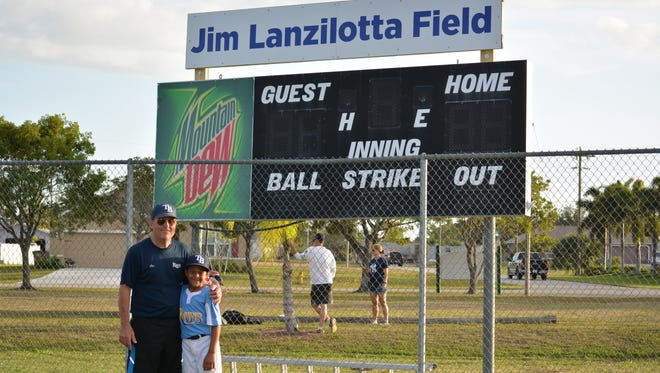 Jim Lanzilotta and Nick Jones, grandson of Vinnie Saladino, pose under the sign honoring the longtime manager at Koza-Saladino Park.