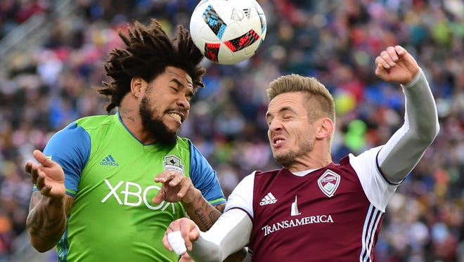 Roman Torres #29 of Seattle Sounders and Kevin Doyle #9 of Colorado Rapids jump for a header during the first half at Dick's Sporting Goods Park on November 27, 2016 in Commerce City, Colorado.
