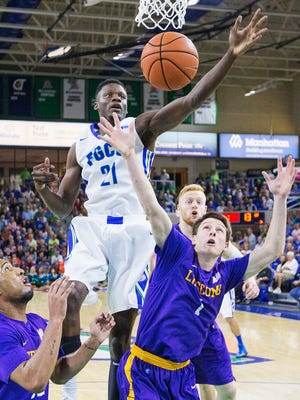 FGCU's Demetris Morant rebounds against Lipscomb during play Thursday at Alico Arena in Fort Myers. FGCU beat Lipscomb 82-67.