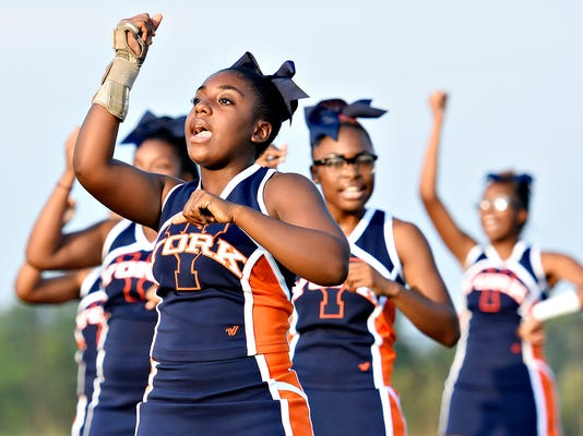 William Penn Keelijah Lawson, 13, and other cheerleaders perform during a celebration of William Penn Senior High School athletes and musicians at Small's Field in York, Pa. on Thursday, Sept. 3, 2015. Dawn J. Sagert - dsagert@yorkdispatch.com