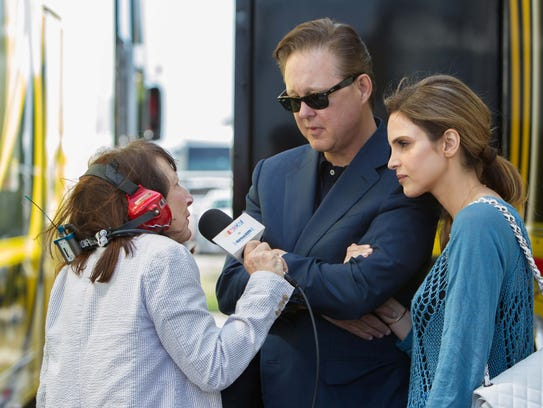 Brian France, center, and wife Amy, right, are interviewed