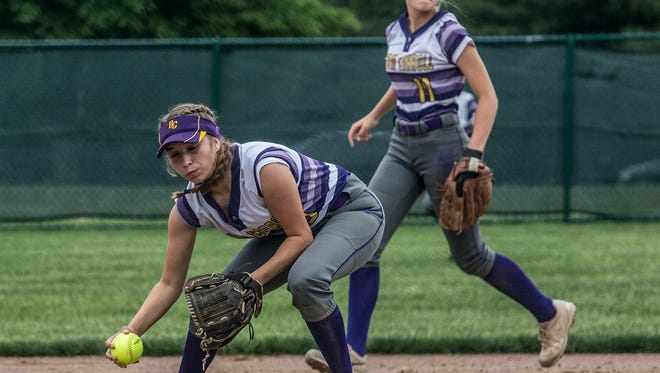 Bloom-Carroll junior third baseman Madison Smith prepares to make a throw to first base Wednesday during a Division II district semifinal against Granville at Pickerington Central. The Bulldogs led 2-1 in the sixth inning but fell 7-2.