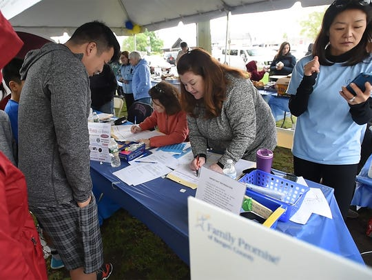 Participants register for activities during Sunday's