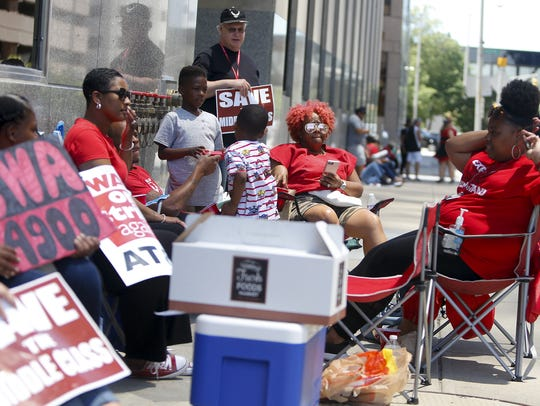 Nicci Orr, middle, listens during the CWA protest at