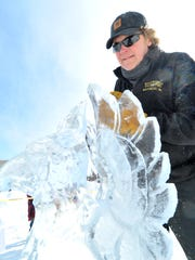 In this file photo, Carver Jon Mykkanen, of Ishpeming, MI, carves an ice sculpture during the 2014 Winter Fest at The 400 Block in downtown Wausau.