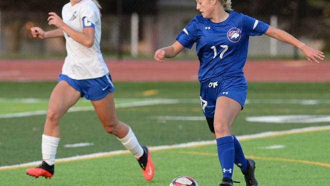 Fort LeBoeuf High School sophomore Elise Cacchione, right, took this ball and scored the first goal of the match against Seneca at Carm Bonito Field on Sept. 22, 2020, in Waterford.