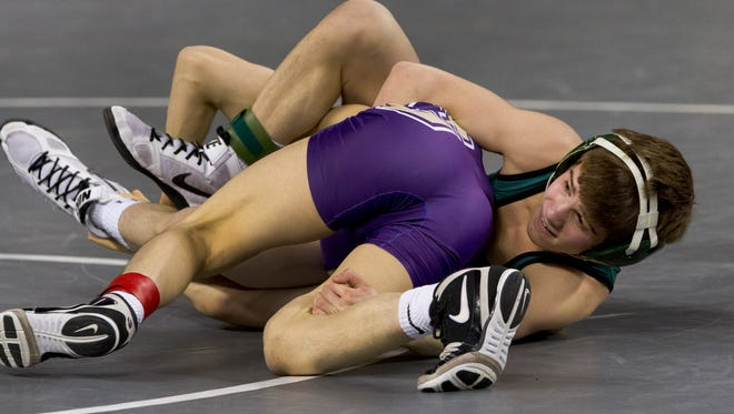 South Plainfield's Joe Heilman tries to keep control during his 106 lbs match against Garfield's Joshua Ferreira. Friday night Pre-Quarters round at NJSIAA State Wrestling Tournament in Atlantic City, NJ on March 4, 2016
